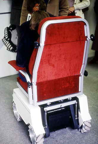 Wheelchair - Wheelchair fitted with Mecanum wheels, taken at an exhibition in the early 1980s