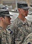 Members of the New York State Guard stand at attention in the rain.jpg