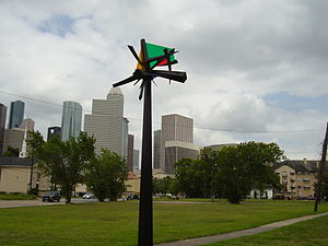 Midtown, Houston - A marker indicating Midtown with Downtown Houston's skyline in the background