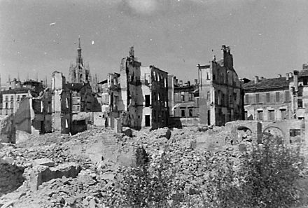 Building destroyed in Milan after the August 1943 bombings. Milan Cathedral is visible in the background. Milan after Bombing.jpg