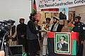 Mohibullah Samim presenting a certificate.jpg