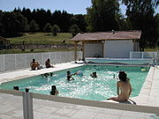 Families enjoying the swimming at Monts de Bussy, Haute Vienne, France.
