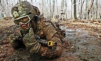 Crawling (human) - Soldier crawls through mud during training