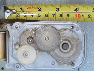 Gear - Multiple reducer gears in an electric motor (ruler for scale)