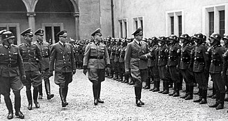 Sonderdienst - Leaders of General Government during inspection of Sonderdienst battalions: from right, Generalgouverneur Hans Frank, Chief of the Police GG Herbert Becker and secretary of state Ernst Boepple