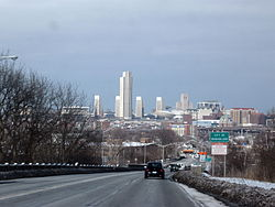 US 9 and 20 entering Rensselaer, with Albany's skyline looming across the Hudson River