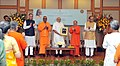 Narendra Modi releasing a commemorative coin to mark the birth centenary of Swami Chinmayananda, at a function, in New Delhi. The Union Minister for Finance, Corporate Affairs and Information & Broadcasting.jpg
