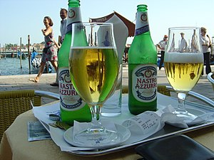 Peroni Brewery - Nastro Azzurro at a sidewalk cafe in St Mark's Square, Venice, Italy.