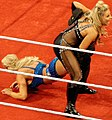 Natalya applying the Sharpshooter on Charlotte.jpg