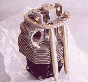 Air-cooled engine - A cylinder from an air-cooled aviation engine, a Continental C85. Notice the rows of fins on both the steel cylinder barrel and the aluminum cylinder head. The fins provide additional surface area for air to pass over the cylinder and absorb heat.