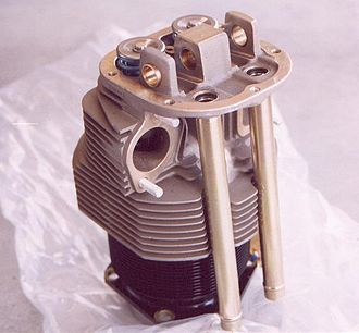 Internal combustion engine cooling - A cylinder from an air-cooled aviation engine, a Continental C85. Notice the rows of fins on both the steel cylinder barrel and the aluminum cylinder head. The fins provide additional surface area for air to pass over the cylinder and absorb heat.