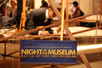 Night at the Museum: Battle of the Smithsonian - Night at the Museum label on the Wright Flyer exhibit in the National Air and Space Museum.