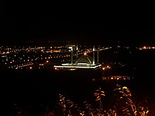A night view of King Faisal Mosque and the surrounding neighbourhood in Islamabad, Pakistan.
