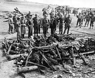 Holocaust denial - April 12, 1945: Generals Dwight D. Eisenhower, Omar Bradley and George S. Patton inspect an improvised crematory pyre at Ohrdruf forced labor camp.