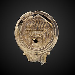 Oil lamp depicting circus games