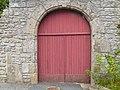 Old red church door in Kerlouan village, Finistére.jpg