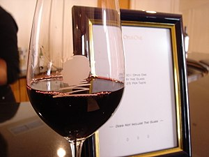 A glass of the California Meritage wine Opus O...