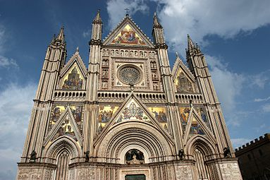 The Gothic Facade Of Orvieto Cathedral Is Veneered With Polychrome Marble And Set Like A Reliquary Colorful Mosaics Free Standing Statues