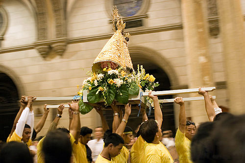 The statue of Our Lady of Peñafrancia in procession to the high altar of Manila Cathedral. - Spanish influence on Filipino culture