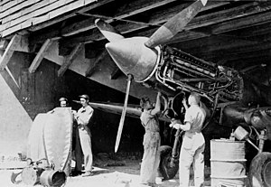 23d Fighter Group - Ground crews servicing a P-40 of the 23d FG in 1942.