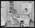 P.C. Goins, section foreman, and family eat dinner in kitchen in their home in company housing project. Koppers Coal... - NARA - 540917.tif