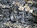 Partially devitrified rhyolitic obsidian (Roaring Mountain Member, Plateau Rhyolite, Upper Pleistocene, ~59 ka; Obsidian Cliff, Yellowstone, Wyoming, USA) 29 (46764130282).jpg