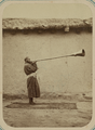 Pastimes of Central Asians. Musicians. A Man Playing a Karnay, a Long-necked Trumpet-like Instrument WDL10827.png