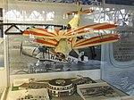 Petőfi Csarnok, Repüléstörténeti kiállítás, Bücker Bü 133C Jungmeister modellje és a Budaörsi repülőtér épületének makettje.JPG