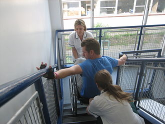 Phil Packer - Packer learning how to climb stairs at RNOH Stanmore as a wheelchair user