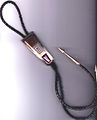 Phillip Sekaquaptewa bolo tie, circa 1988, contemporary Hopi silver overlay with stone and shell (12583614404).jpg