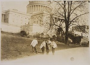 Photograph of news-boys selling near the Capit...