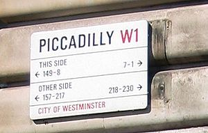 "Street sign reading ""Piccadilly W1; this side 149-8, 7–1; other side 157–217, 218–230; City of Westminster"""