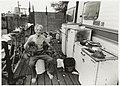Piet Snel op het steiger van zijn caravan samen met zijn honden. Terrein van het voormalige Conrad Stork. NL-HlmNHA 54035309.JPG