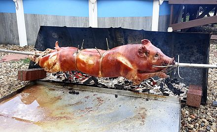 A pig roasting on a rotating spit