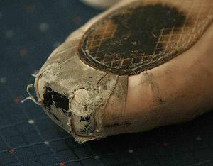 Typical wear on a pointe shoe. The fabric has ...