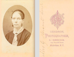 Portrait of bespectacled woman by Gendron of Watertown NY.png