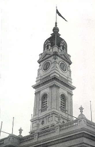 Prahran Football Club - The VFA premiership flag flies above Prahran Town Hall in celebration of the Prahran Football Club's Grand Final victory, 1951