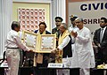 Pranab Mukherjee being felicitated at the civic reception programme under the aegis of the Agartala Municipal Council, at Agartala. The Governor, Tripura, Shri Devanand Konwar and the Chief Minister of Tripura.jpg