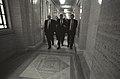 President Bill Clinton walks along a corridor at the Parliament Building in Belfast with Seamus Mallon and David Trimble.jpg