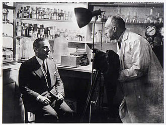 """National Laboratory of Psychical Research - Harry Price testing the medium Pasquale Erto at the laboratory in 1931 – the """"Luminous Man"""" from Naples was exposed as a fraud."""