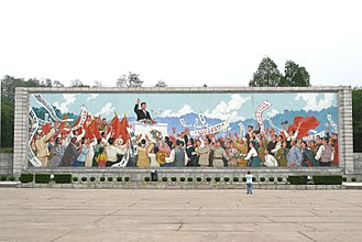North Korean cult of personality - A mural of Kim Il-sung giving a speech in Pyongyang.