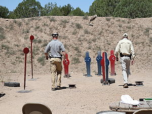 Gunsite Academy - Industry and media representatives checking out new pistols on pistol range 2
