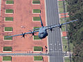 RAAF Lockheed C-130J-30 Hercules flies up Anzac Parade, Canberra.jpg