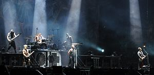 Rammstein performing in August 2013; upper level (left to right): Oliver Riedel, Christoph Schneider, Christian Lorenz; lower level (left to right): Paul Landers, Till Lindemann, Richard Kruspe