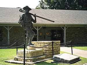Texas Ranger Hall of Fame and Museum - Main entrance to the Texas Ranger Hall of Fame and Museum in Waco, Texas. The statue is of George Erath, Texas Ranger and surveyor of the Waco townsite.