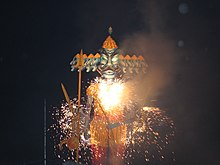 Statue lit up with sparklers at night