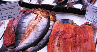 "Kipper - ""Red herring"": Cold smoked herring (Scottish kippers), brined so that their flesh achieves a reddish colour"