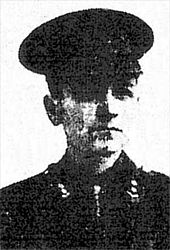 A black and white army portrait of Ronald Lindsay Johnson. He is in uniform, wearing a hat.