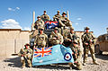 Royal Australian Air Force security force members pose with the RAAF ensign in Afghanistan.jpg