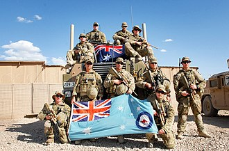 Royal Australian Air Force Ensign - RAAF airfield defence guards posing with the RAAF Ensign and the Australian national flag in Afghanistan